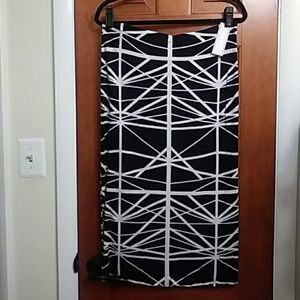 Black and cream colored patterned skirt
